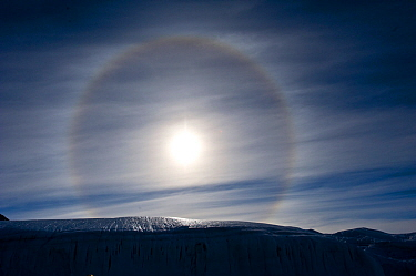 Sun Dog, or Parhelion, caused by refraction of the sun's rays, more commonly seen in Antarctica, above glacier, Dry Valleys, Antarctica, December 2009 Taken on location for the BBC series, Frozen Plan...  -  Jeff Wilson/ npl