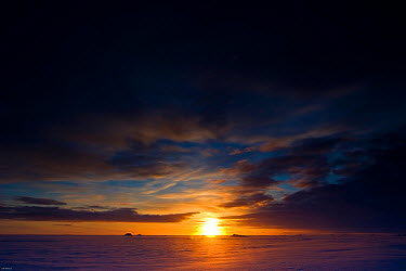The sun returns for the first time to Svalbard, Norway, in the High Arctic after an absence of six months during the Arctic winter, February 2009 Taken on location for the BBC series, Frozen Planet  -  Jeff Wilson/ npl