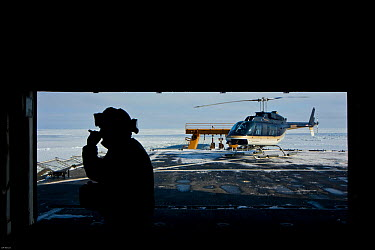 Helicopter and crew on deck of US Coastgaurd ship 'Healy' in frozen Bering Sea, Alaska, March 2008 Taken on location for the BBC series, Frozen Planet  -  Jeff Wilson/ npl