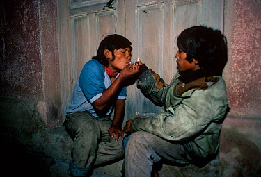 Child street addicts smoking crack cocaine Cochabamba, Bolivia  -  Jeff Rotman/ npl