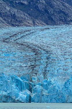Black streaks (medial moraine) in the Dawes Glacier are indicative of two glaciers colliding or joining together Alaska, July 2011  -  Charlie Summers/ npl