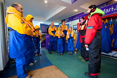 Group of tourists wearing waterproof clothing and life jackets preparing for zodiac boat tour to Bass Rock, North Berwick, Firth of Forth, Lothian, Scotland, UK, August 2011  -  Peter Cairns/ 2020V/ npl