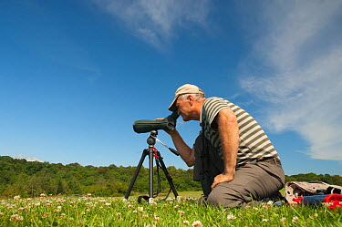 Birdwatcher watching Red Kite in the Urban Red Kite area of the Derwent Valley, Gateshead, Tyne and Wear, UK, on the edge of Tyneside following on from the 'Northern Kites' re-introduction programme b...  -  Rob Jordan/ 2020V/ npl