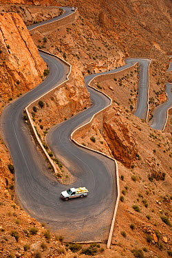 Truck driving up mountain pass, Dades Gorge, Morocco, March 2011  -  Ernie Janes/ npl