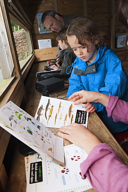 Family looking at identification sheets on visit to the Westhay Nature Reserve, Somerset Levels, UK, June 2011  -  Paul Hobson/ 2020V/ npl