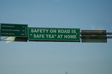 Amusing road safety sign above road on road to Hyderabab, capital of Andhra Pradesh, India  -  Michael W. Richards/ npl