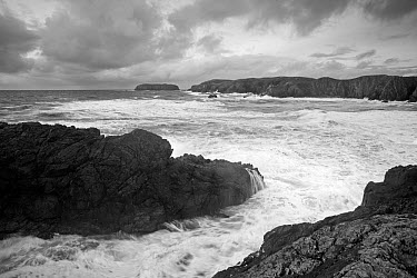 Monochrome image of stormy waves breaking on rocks, looking out to sea, Traigh Mangerstadh, Isle of Lewis, Outer Hebrides, Scotland, UK, October  -  Peter Cairns/ 2020V/ npl