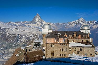 Gornergrat Station with observatory domes, Monte Rosa and Cervino (The Matterhorn) massif on the horizon, Pennine Alps, Switzerland, April 2011  -  Inaki Relanzon/ npl