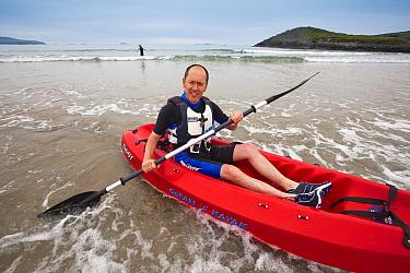 Man sea kayaking at Caerfai Bay on the Pembrokeshire Coast Path, Wales, UK, June 2009  -  Nick Turner/ npl