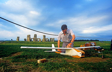 Clive Hall preparing glider painted to look like a stork for remote control aerial filming for 'In-Flight Movie', with Stonehenge in background, Wiltshire, England, UK, 1986  -  John Downer/ npl