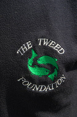 Tweed Foundation badge and logo on a staff t-shirt, Berwickshire, Scotland, UK, August 2011  -  Rob Jordan/ 2020V/ npl