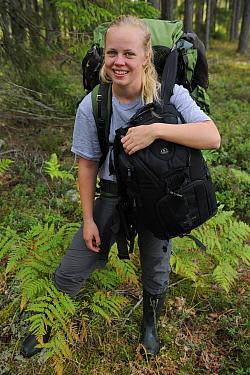 Liisa Widstrand, carrying photography equipment, Karmansbo, Vastmanland, Sweden August 2011 Model released  -  Staffan Widstrand/ npl
