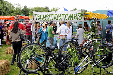 Transition Towns Stall surrounded by people with upsidedown bicycles in front, London Green Fair (previously Camden Green Fair) England UK, June 2011  -  Pat Tuson/ npl