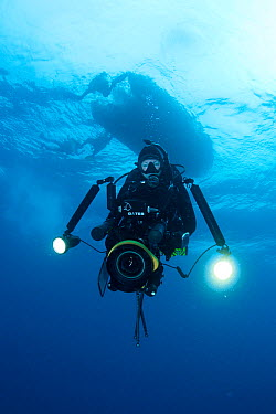 Female scuba diver and filmmaker with large underwater camera system Galapagos Islands, August 2010 Model released  -  Michele Westmorland/ npl