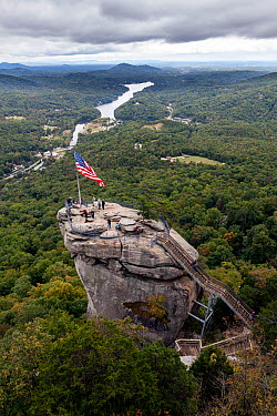 American stars and stripes flag on top of Chimney Rock in Chimney Rock State Park North Carolina, USA, October 2013  -  Kirkendall-spring/ npl