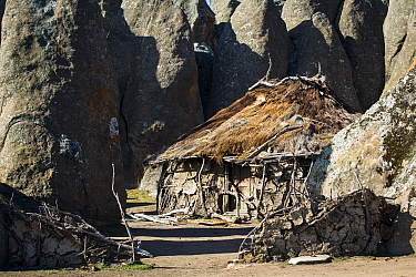 Hut in amongst the granite formations of Rafu Bale Mountains National Park, Ethiopia, December 2011  -  Will Burrard-Lucas/ npl