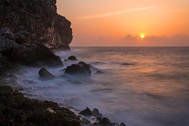 Sun rising over cliffs of Cayman Brac, Cayman Islands  -  Will Burrard-Lucas/ npl