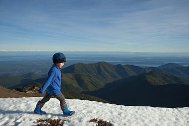 Young toddler boy walking on snow-covered mountain summit, Mount Townsend, northwest Olympic National Park, Olympic Peninsula, Washington, USA November 2013  -  Steven Kazlowski/ npl