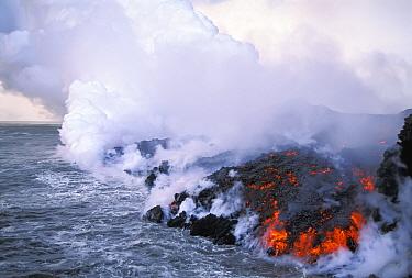 A?a lava flow entering the sea dusk, Cape Hammond, Fernandina Island, Galapagos  -  Tui De Roy/ npl