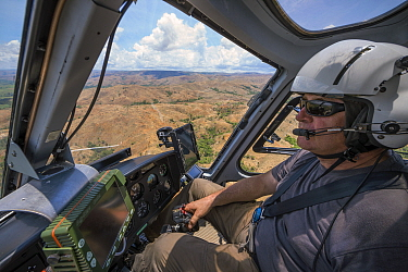 Food and Agriculture Organization (FAO) helicopter pilot Eric Gadot, an expert at locust control operations flying over effected area, near Miandrivazo, Madagascar December 2013  -  Ingo Arndt/ npl