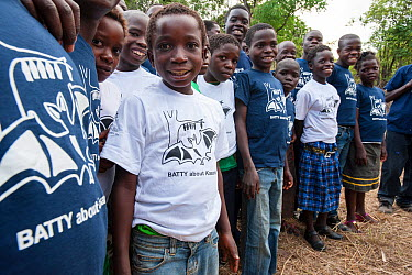 Local school children proudly wearing Kasanka Trust t-shirts on a visit to the National Park to see the mass aggregations of straw-coloured fruit bats (Eidolon helvum) Kasanka National Park, Zambia No...  -  Nick Garbutt/ npl