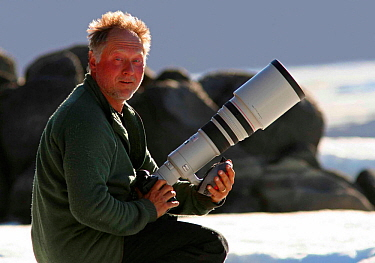 Photographer Ian McCarthy with camera waiting to photograph walruses, Ellesmere Island, Nunavut, Canada  -  Ian Mccarthy/ npl