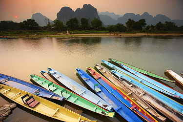 Colourful canoes moored on the Nam Song River at Vang Vieng, Laos, March 2009  -  David Noton/ npl