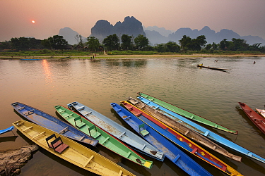 Canoes on the moored on the Nam Song River at Vang Vieng, Laos, March 2009  -  David Noton/ npl