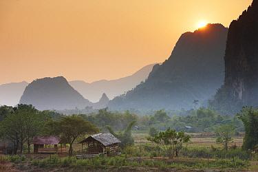 Sun setting over mountains near Vang Vieng, Laos, March 2009  -  David Noton/ npl
