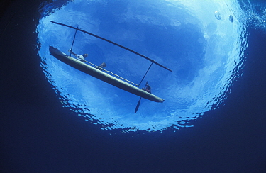 Traditional outrigger canoe of a Papuan fisherman viewed from underwater, Papua New Guinea  -  Jurgen Freund/ npl