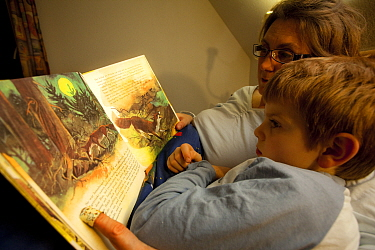 Mother and son, reading story book about foxes Black Forest, Germany  -  Klaus Echle/ npl