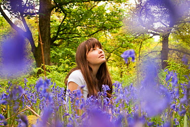 Girl sitting amongst flowering Bluebells (Hyacinthoides non-scripta) in woodland, Cumbernauld Glen, North Lanarkshire, Scotland, UK, May 2011 2020VISION Exhibition  -  Katrina Martin/ 2020V/ npl