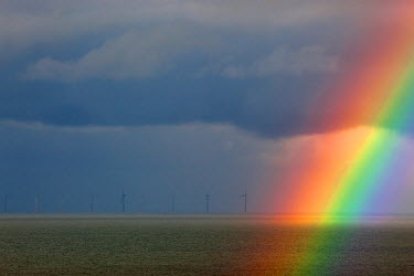 Sherringham off shore windfarm in distance, and rainbow during storm, Weybourne, Norfolk, November  -  Ernie Janes/ npl