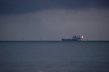 African offshore petroleum reserves, with petroleum tanker and gas burning off, oil discovery in the Atlantic Ocean off the shores of Equatorial Guinea and Cameroon, Central Africa  -  Jabruson/ npl