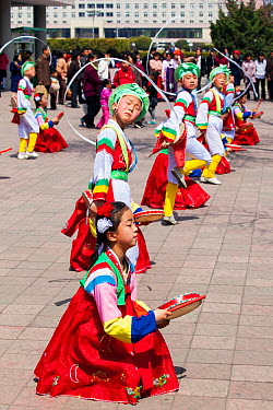 Children in traditional dress dancing during street celebrations on the 100th anniversary of the birth of President Kim IL Sung, Pyongyang, Democratic Peoples' Republic of Korea (DPRK), North Korea, A...  -  Gavin Hellier/ npl