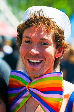 Man dressed up wearing rainbow coloured bow tie, celebrating Lesbian Gay Bisexual Transgender Pride Parade, an annual event, San Francisco, California, USA, June 2011  -  Gavin Hellier/ npl