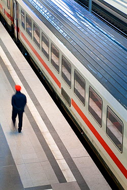 Train pulling into new modern main railway station, with man on platform, Berlin, Germany 2009  -  Gavin Hellier/ npl