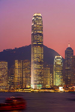 Giant skyscraper of the International Finance Centre towering over the Hong Kong skyline at 88 stories and 415m tall, illuminated at night, Hong Kong, China 2007  -  Gavin Hellier/ npl