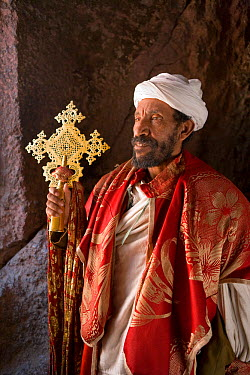 Priest in Bet Danaghel Church holding the Cross of King Lalibela The rock-hewn churches of Lalibela make it one of the greatest Religio-Historical sites not only in Africa but in the Christian World,...  -  Gavin Hellier/ npl