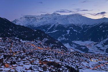 Resort of Four Valleys region and mountains at dusk, Valais, Verbier, Bernese Alps, Switzerland January 2009  -  Gavin Hellier/ npl