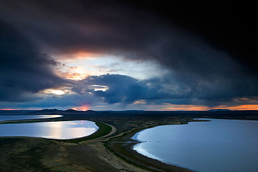View over the Campbell Lakes with stormy clouds at dusk, viewed from Walker Valley Overlook in Hart Mountain National Antelope Refuge, Oregon, USA, May 2013.