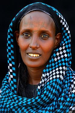 Head portrait of Afar tribe woman with facial tattoo /  skin scarifications and wearing head scarf, Malab-Dei village, Danakil depression, Afar region, Ethiopia, March 2015.