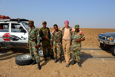 Photographer Eric Baccega in salt desert with military escort required to travel in this region. Danakil Depression. Ethiopia, March 2015.