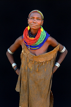 Woman of the Nyangatom tribe with traditional jewels and leather dress, Omo Valley, Ethiopia, March 2015.