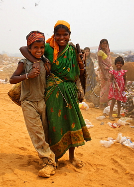 Mother and child rag pickers in landfill site, Guwahti, Assam, India, March 2009.