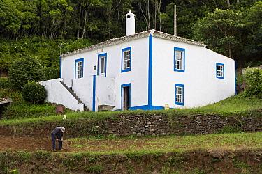Man working in front of his house at Santa Barbara, Santa Maria Island, Azores, Portugal, Atlantic Ocean.