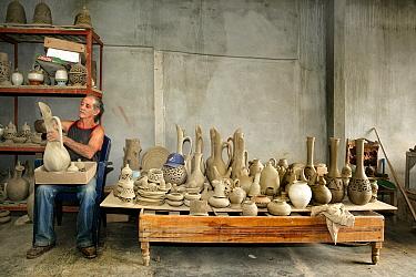 Cuban pottery craftsman in his workshop, Trinidad City, Sancti Spiritus Province, Cuba, Caribbean, July 2008.