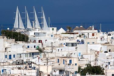 White houses in Mykonos Town with luxury ship Wind Star in the background. Mykonos Island, Cyclades, Aegean Sea, Mediterranean, Greece, August 2007