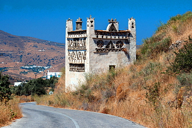 Tinos Dovecotes, The island of Tinos is famous for its many intricately designed dovecotes. Tinos island, Cycladic islands, Aegean Sea, Greece, Mediterranean, August 2014.
