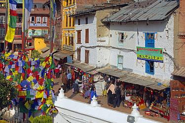 Shops and prayer flags around Bodnath,the largest stupa in Nepal, Durbar Square, Kathmandu, Nepal. November 2014.